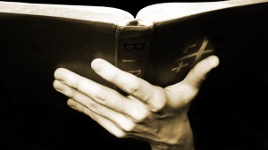 holding-the-bible-1498772